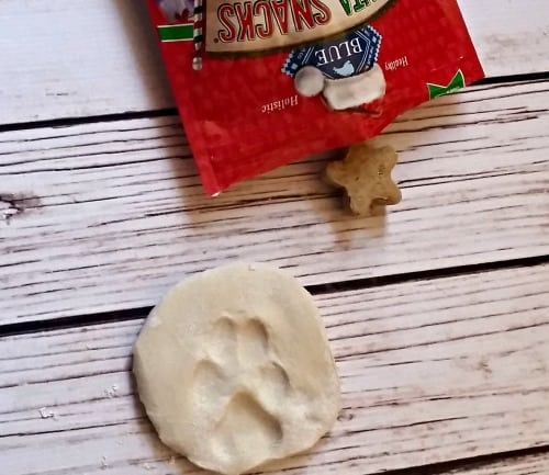 This DIY dog salt dough ornament recipe is so easy to make. Have a cute paw print ornament hanging from your Christmas tree this year. Don't buy a kit, just do this homemade version instead. It can be a new family tradition!