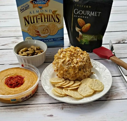 This easy almond cheese ball recipe is so simple and delicious. It makes a perfect appetizer for your summer entertaining, cookout, or BBQ. Take the classic cheese ball up a notch with this recipe.