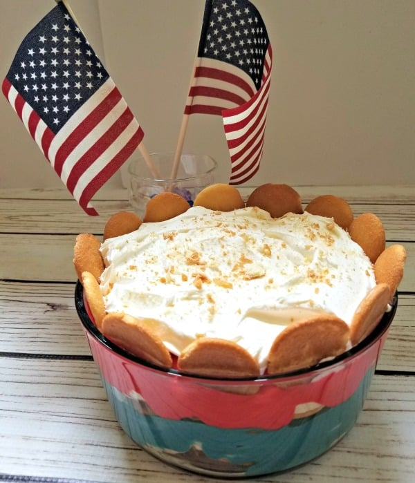 This easy Red, White, and Blue No Bake Banana Pudding recipe is a simple Fourth of July dessert that is perfect for a crowd. It is made with cream cheese and cool whip for a perfect summer treat.