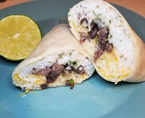 Make this slow cooker beef burritos recipe for a quick and easy meal when you are on a budget. This $10 dinner idea is also great for tacos. Use your crock pot to make cheap dinners for a family.