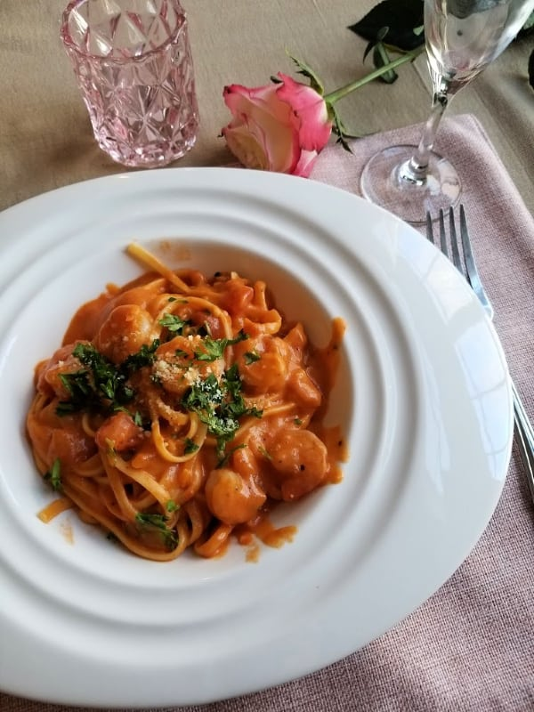 Make this easy Garlic Shrimp Pasta in Rosa Sauce for a simple Valentine's Day dinner idea for two. This creamy and simple recipe is the best for a romantic date night at home.